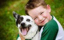 Child-lovingly-embraces-his-pet-dog