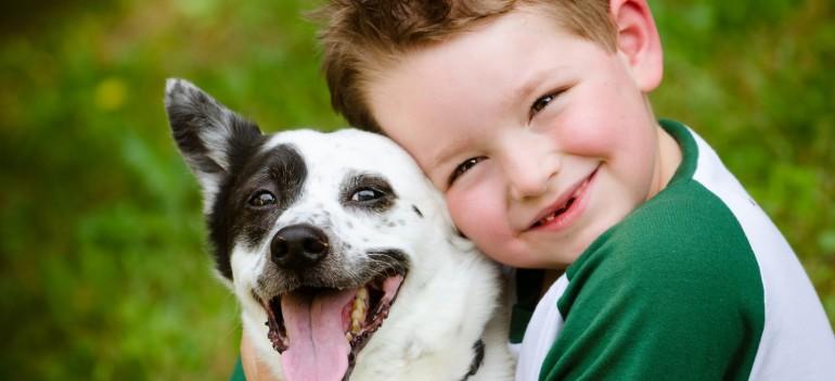 Child-lovingly-embraces-his-pet-dog